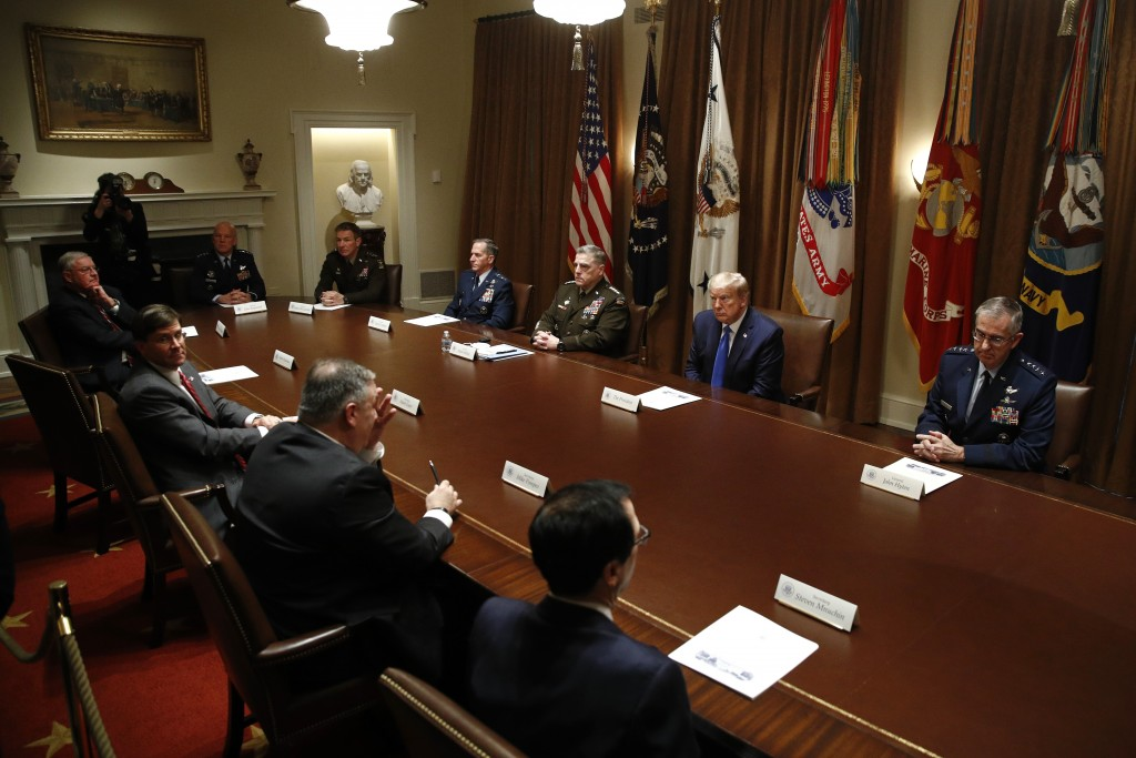 President Donald Trump meets with senior military leaders and members of his national security team in the Cabinet Room of the White House, Saturday, ...