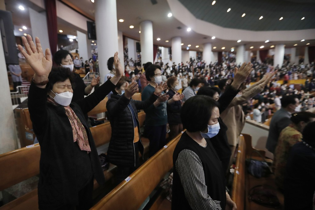 Christians wearing face masks pray during a service at the Yoido Full Gospel Church in Seoul, South Korea, Sunday, May 10, 2020. South Korea's Preside...