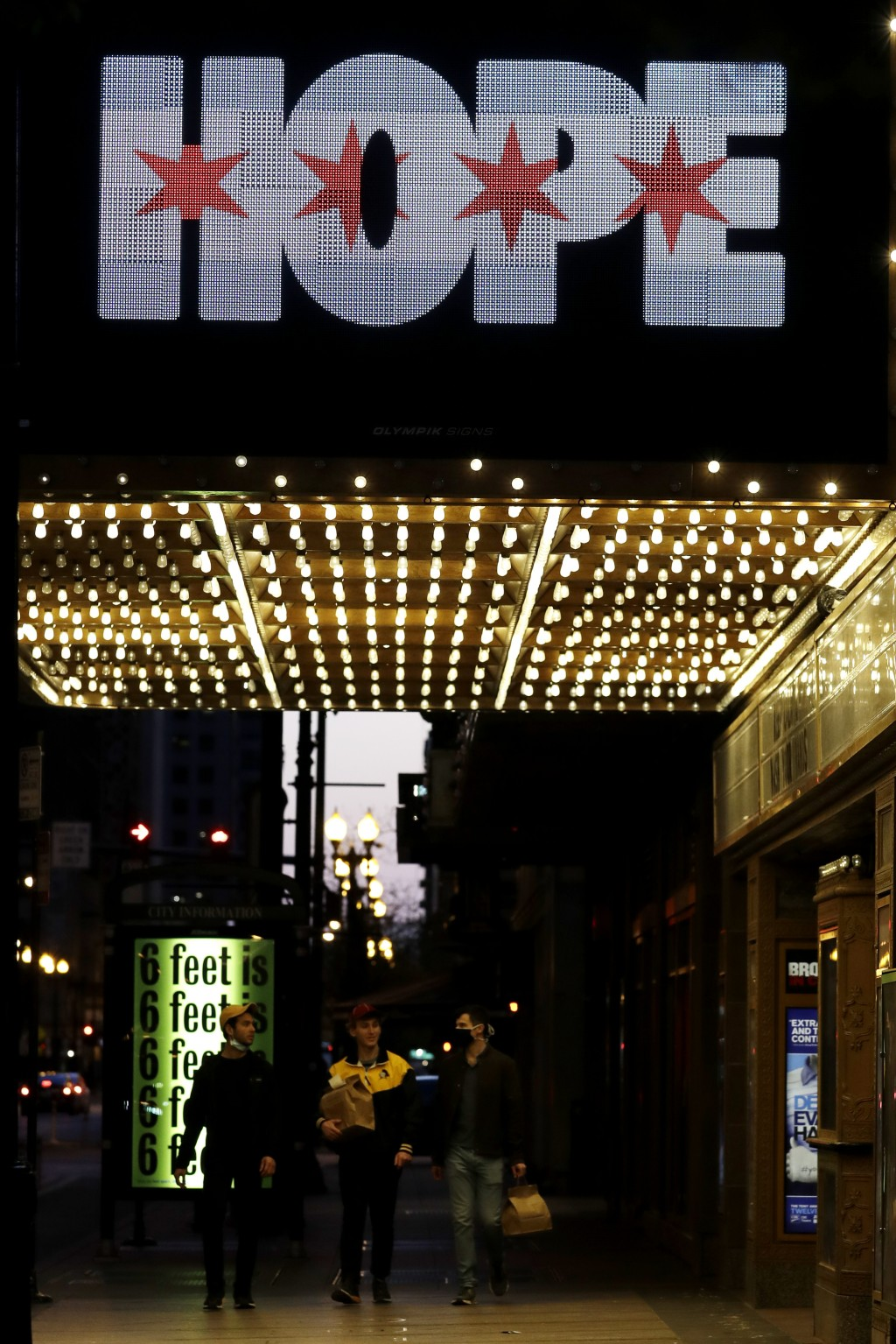"""The marquee of the James M. Nederlander Theatre reads """"HOPE"""" in downtown Chicago, Saturday, May 9, 2020, during the COVID-19 pandemic. (AP Photo/Nam Y..."""