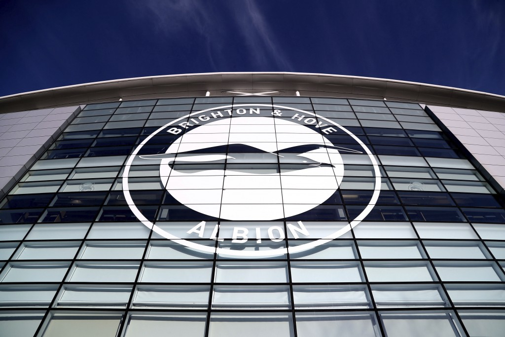 FILE - This Jan, 18, 2020 file photo shows a general view of the club crest on the side of the AMEX Stadium, home to Brighton & Hove Albion, Brighton,...