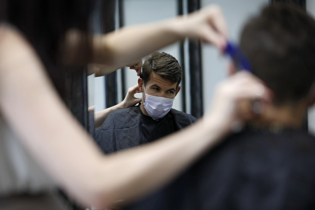 Eden Walton cuts the hair of M. Sibert at Makeshift Union Cutting & Grooming, Saturday, May 9, 2020, in Las Vegas. Saturday was the first day restaura...