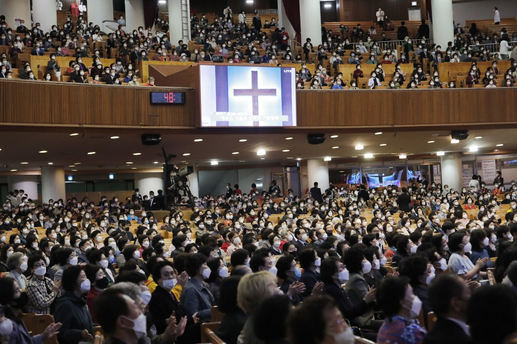 Christians wearing face masks attend a service at the Yoido Full Gospel Church in Seoul, South Korea, Sunday, May 10, 2020. South Korea's President Mo...