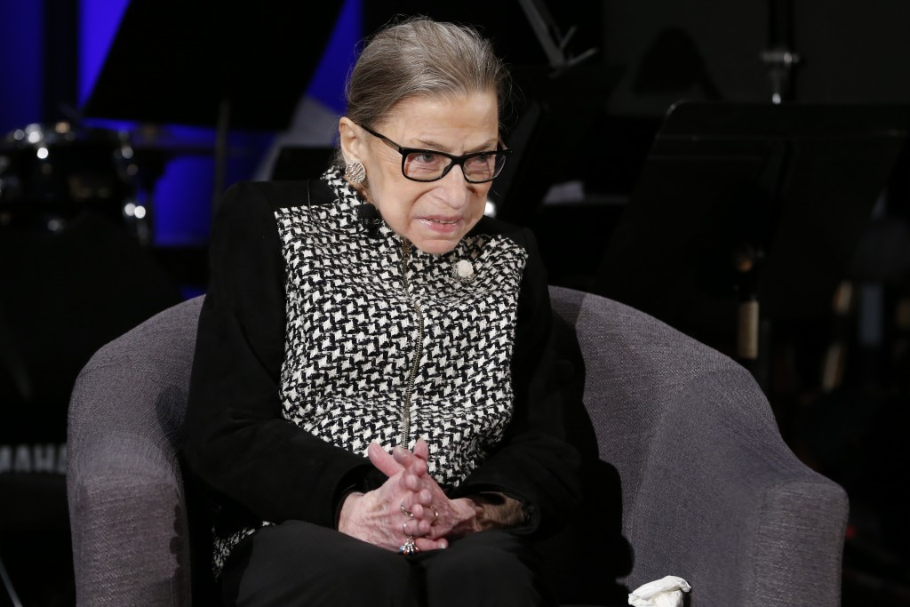 FILE - In this Dec. 17, 2019, file photo Supreme Court Justice Ruth Bader Ginsburg speaks with author Jeffrey Rosen at the National Constitution Cente...