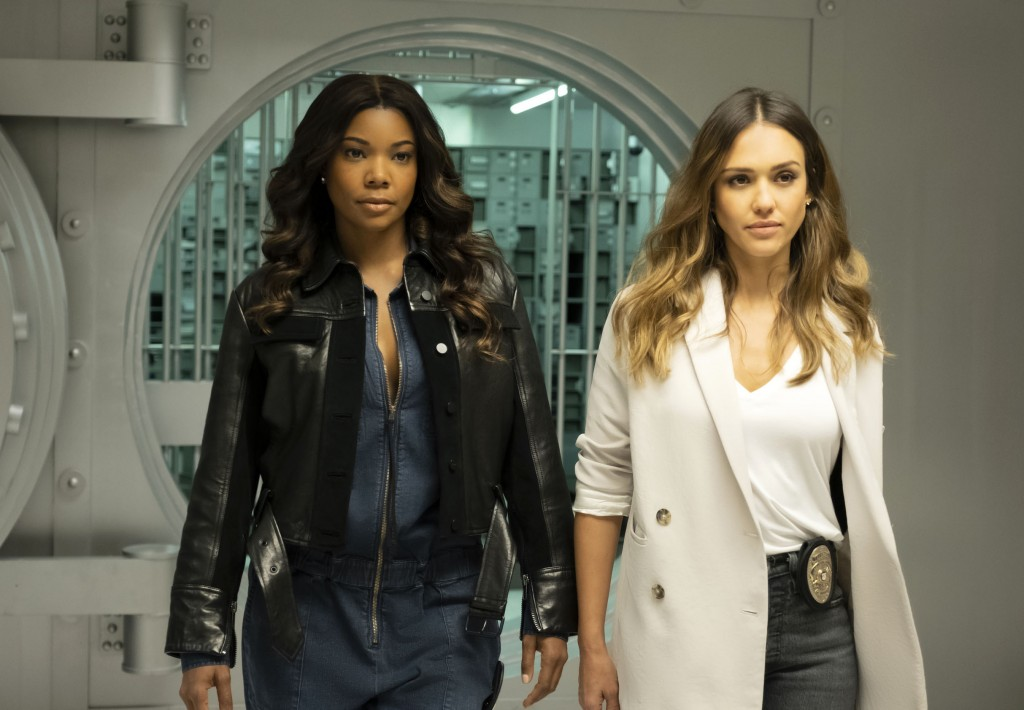 """This image released by FOX hows Gabrielle Union, left, and Jessica Alba in a scene from """"L.A.'s Finest."""" The series will premiere in the fall.  Union ..."""