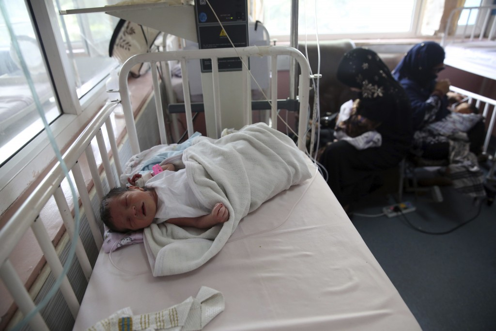 Newborn babies are cred for at the Ataturk Children's Hospital a day after they were rescued following a deadly attack on another maternity hospital, ...