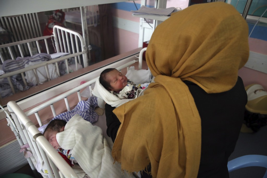 Newborn babies lie in their beds at the Ataturk Children's Hospital a day after they were rescued from a deadly attack on another maternity hospital, ...