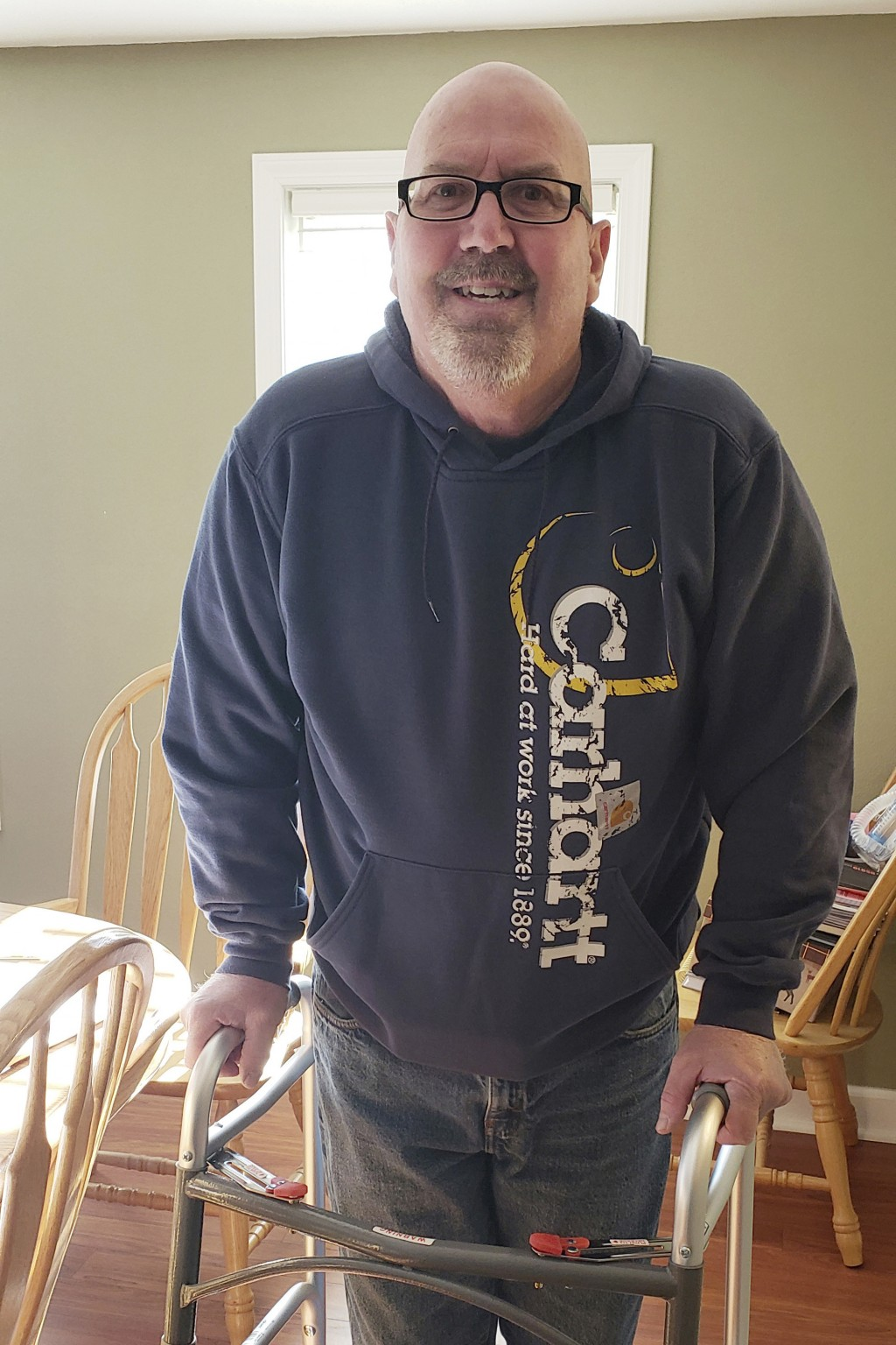 This April 21, 2020 photo provided by Elizabeth Dobbels shows her husband, Scott, at their home in Silvis, Ill. Dobbels spent 17 days in the hospital,...