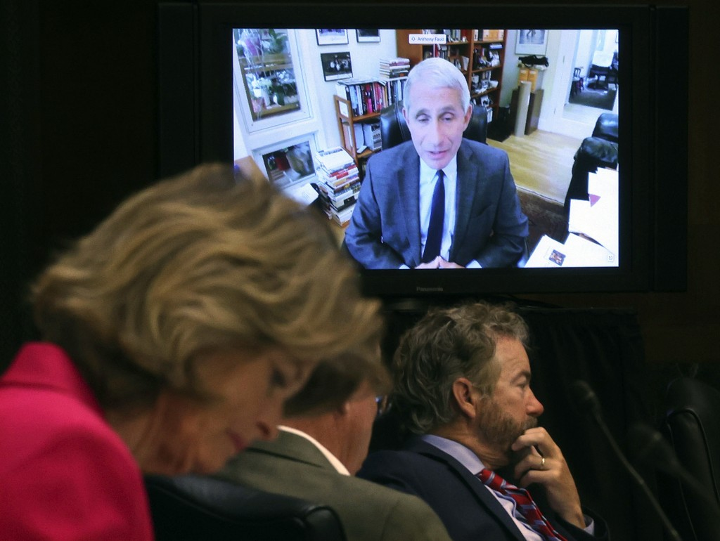 Senators listen as Dr. Anthony Fauci, director of the National Institute of Allergy and Infectious Diseases, speaks remotely during a virtual Senate C...