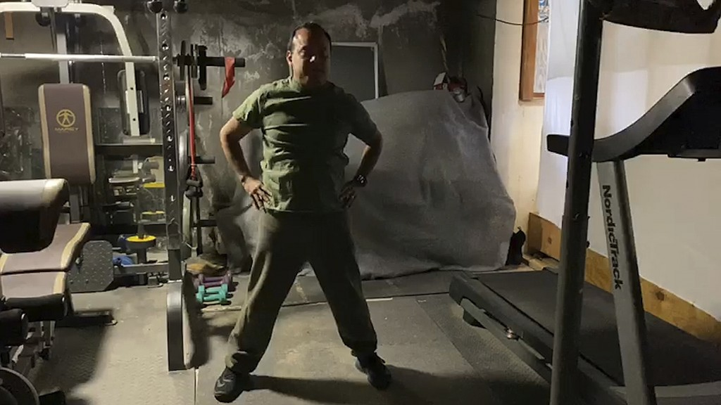 This 2020 image from video provided by Grety Melo shows her husband, Alex, exercising at their home in York, Maine. The retired Marine became critical...