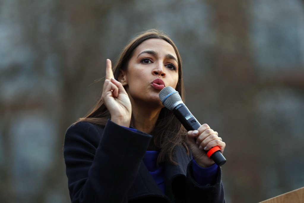 FILE - In this March 8, 2020, file photo Rep. Alexandria Ocasio-Cortez, D-NY., speaks at a campaign rally for then-Democratic presidential candidate S...