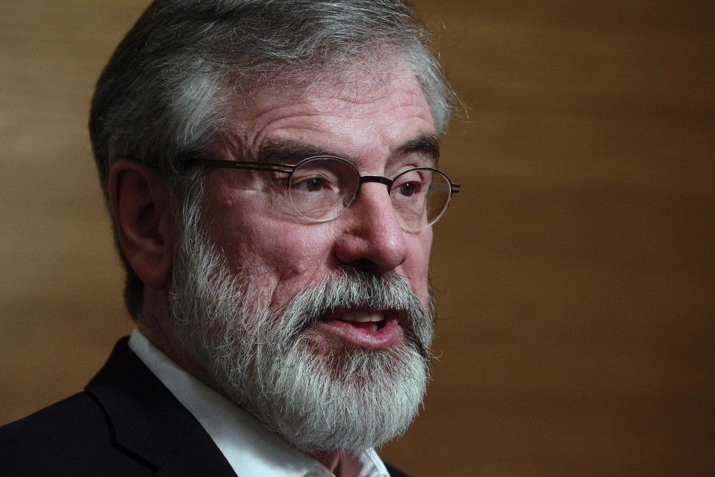 FILE - In this Feb, 28, 2016 file photo, Sinn Fein party leader Gerry Adams talks to members of the media after being elected TD for Louth at the coun...