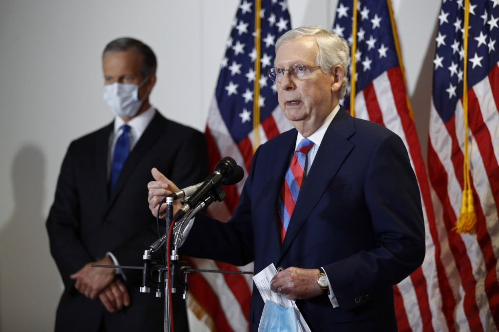 Senate Majority Leader Mitch McConnell of Ky., speaks at a news conference on Capitol Hill in Washington, Tuesday, May 12, 2020. Standing behind McCon...