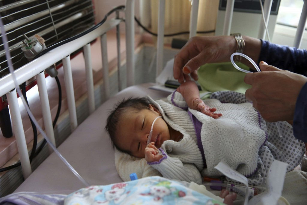 A newborn baby is cared for at the Ataturk Children's Hospital a day after being rescued from a deadly attack on another maternity hospital, in Kabul,...