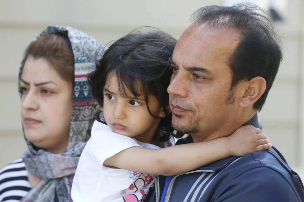 In this April 22, 2020, photo, Afghan refugee Mahmood Amiri poses with daughter Safa, and his wife Masouda, in West Valley City, Utah. Coronavirus res...