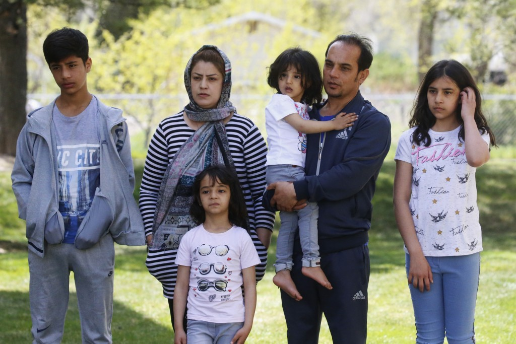 In this April 22, 2020, photo, Afghan refugee Mahmood Amiri poses for a photograph with his family, in West Valley City, Utah. The coronavirus restric...