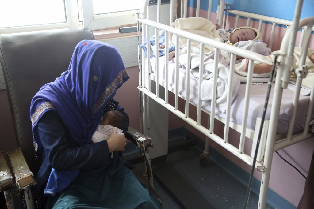 A mother breastfeeds her two-day-old baby at the Ataturk Children's Hospital a day after being rescued from another maternity hospital following a dea...