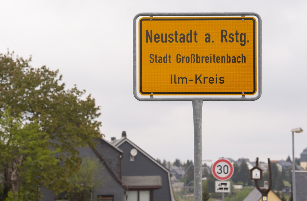 A city sign stand at the entrance during a collective test due to frequent corona infections in Neustadt am Rennsteig, Germany, Thursday, May 14, 2020...
