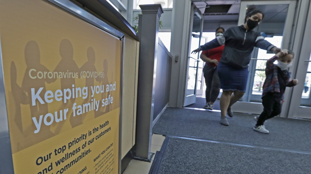 A sign on how to keep your family safe during the coronavirus pandemic rests near an entrance to SouthPark Mall, Wednesday, May 13, 2020, in Strongsvi...