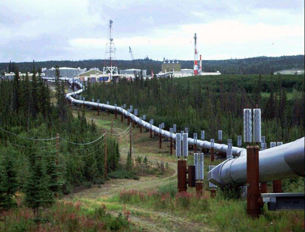 FILE - This undated file photo shows the Trans-Alaska pipeline and pump station north of Fairbanks, Alaska. The future of Alaska's unique program of p...