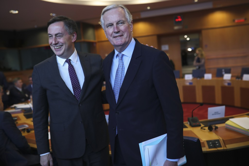 FILE - In this Wednesday, Feb. 5, 2020 file photo, European Commission's Head of Task Force for Relations with the United Kingdom Michel Barnier, righ...