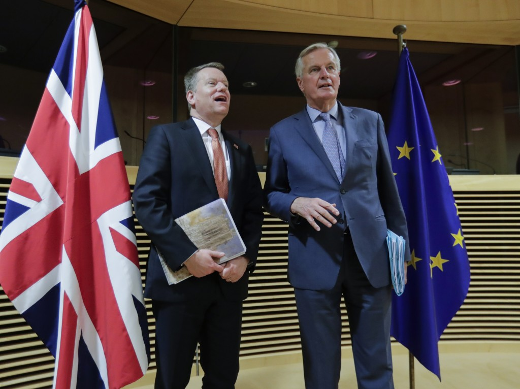 In this Monday, March 2, 2020 file photo, European Commission's Head of Task Force for Relations with the United Kingdom Michel Barnier, right, speaks...