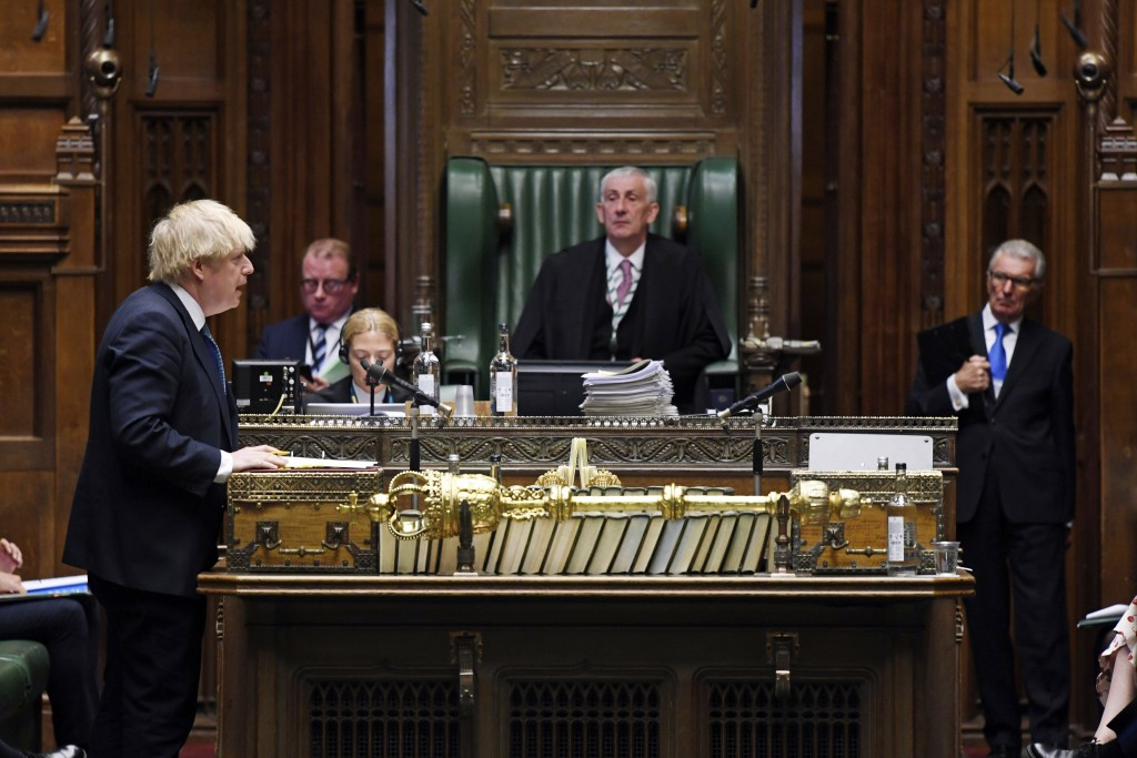 In this handout photo provided by UK Parliament, Britain's Prime Minister Boris Johnson speaks during Prime Minister's Questions in the House of Commo...