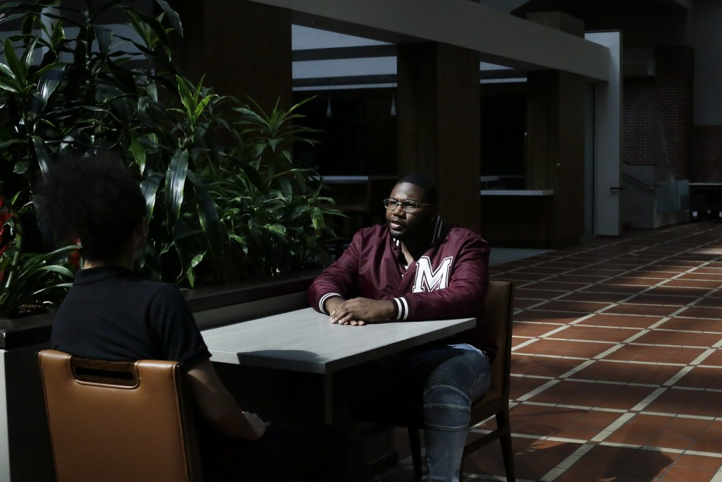 """In this Tuesday, May 5, 2020, photo, Morehouse College senior Lanarion """"LTL"""" Norwood Jr., of Atlanta, sits and talks with fellow student Joseph Ramire..."""