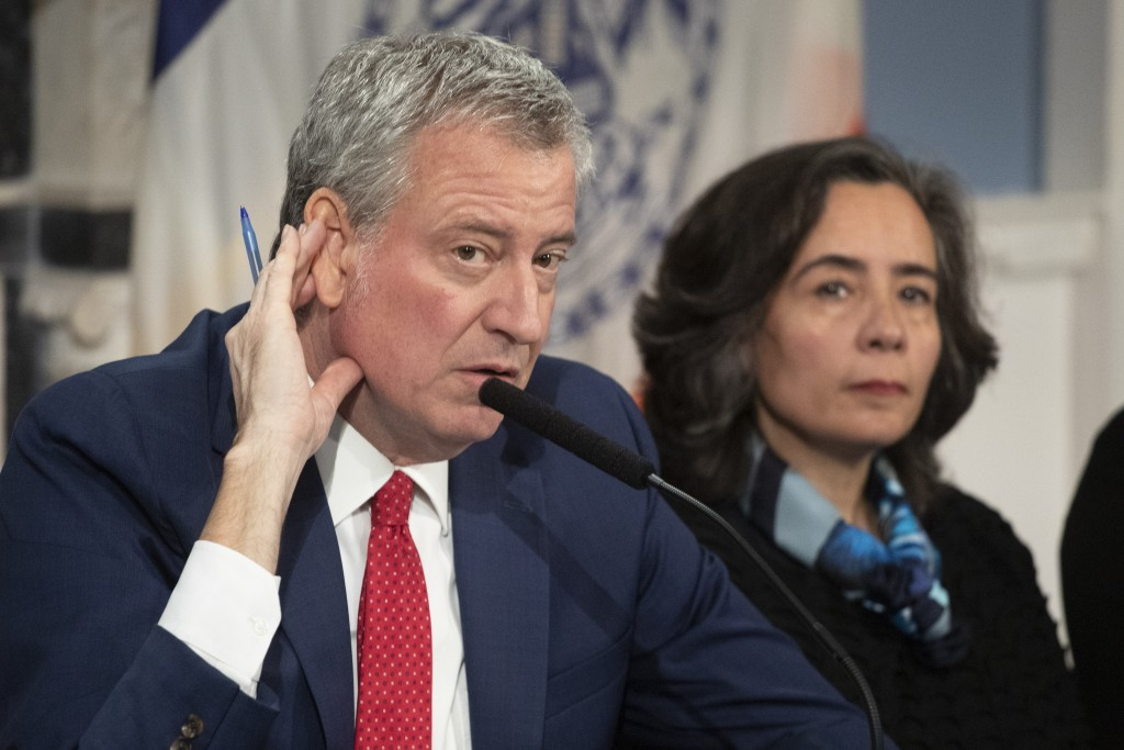 In this Feb. 26, 2020 file photo, Mayor Bill de Blasio, left, with Dr. Oxiris Barbot, commissioner of the New York City Department of Health and Menta...