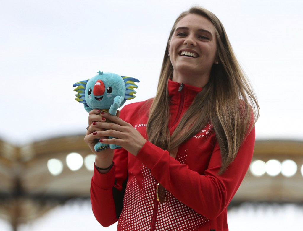 FILE - In this April 14, 2018, file photo, women's pole vault gold medalist Canada's Alysha Newman stands on the podium at Carrara Stadium during the ...
