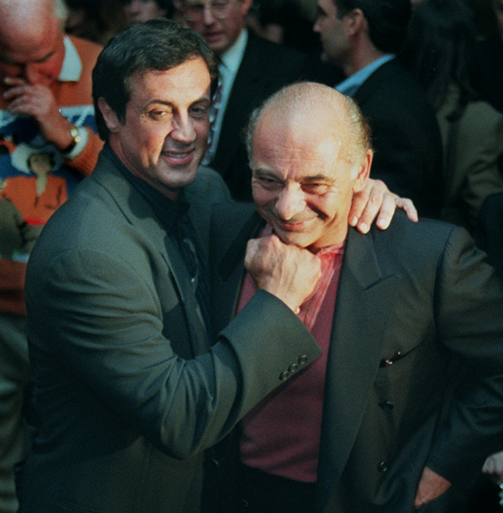 """FILE - In this Nov. 15, 1996, file photo, Sylvester Stallone, left, mugs with """"Rocky"""" co-star Burt Young before a screening of the 1976 film to celebr..."""