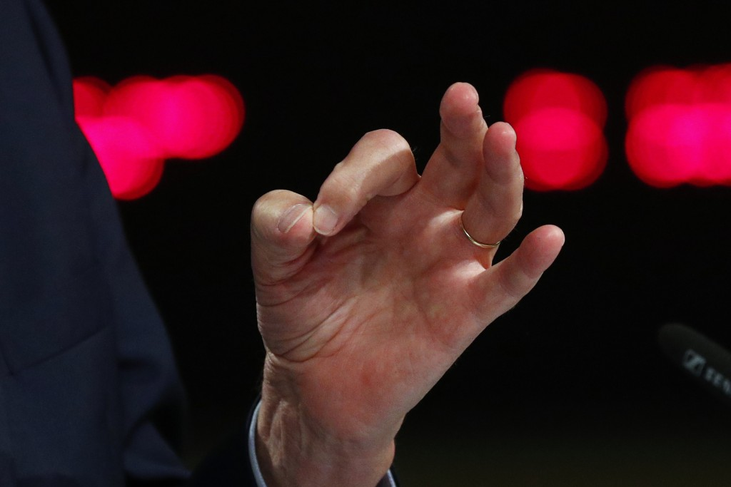 European Union's chief Brexit negotiator Michel Barnier gestures while speaking during a media conference, following the third round of Brexit talks b...