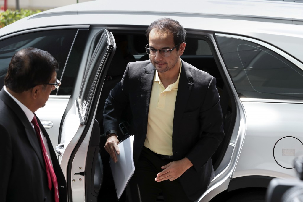 FILE - In this July 3, 2018, file photo, Riza Aziz, right, stepson of Malaysian former Prime Minister Najib Razak, arrives at Anti-Corruption Agency i...