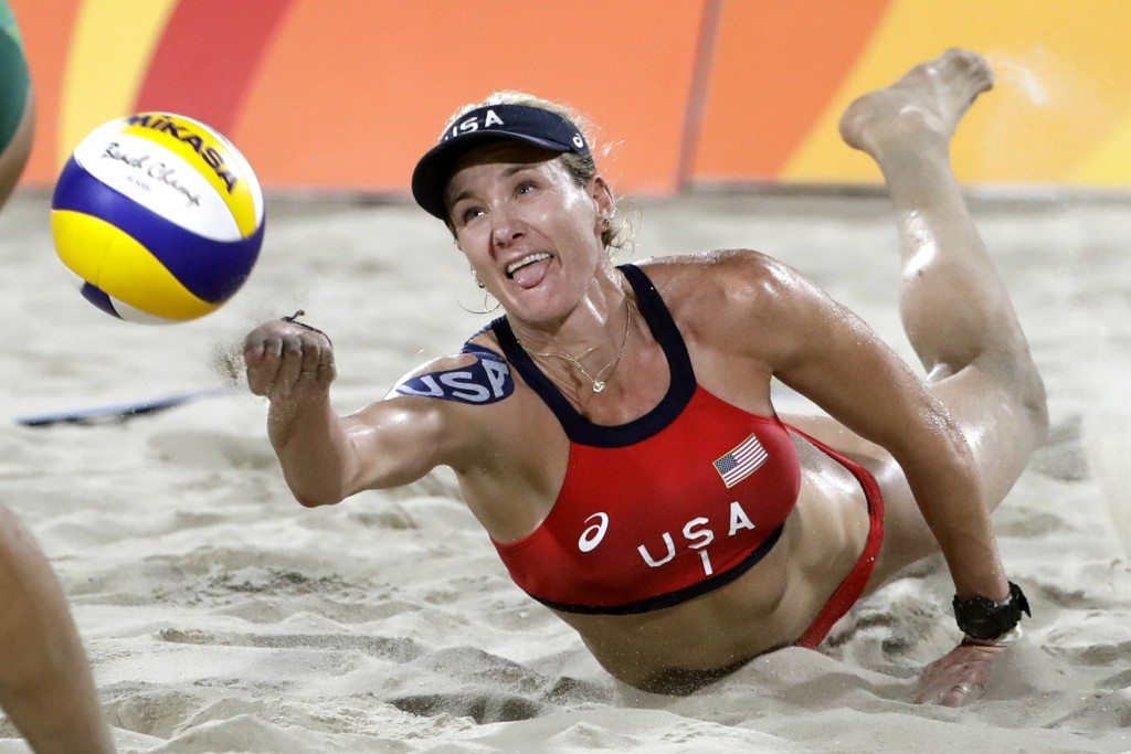 FILE - In this Aug. 17, 2016, file photo, United States' Kerri Walsh Jennings digs for a ball while playing Brazil during the women's beach volleyball...
