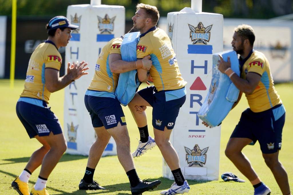 Gold Coast Titans' players of the National Rugby League train on the Gold Coast, Australia, Friday, May 15, 2020. The National Rugby League will resta...