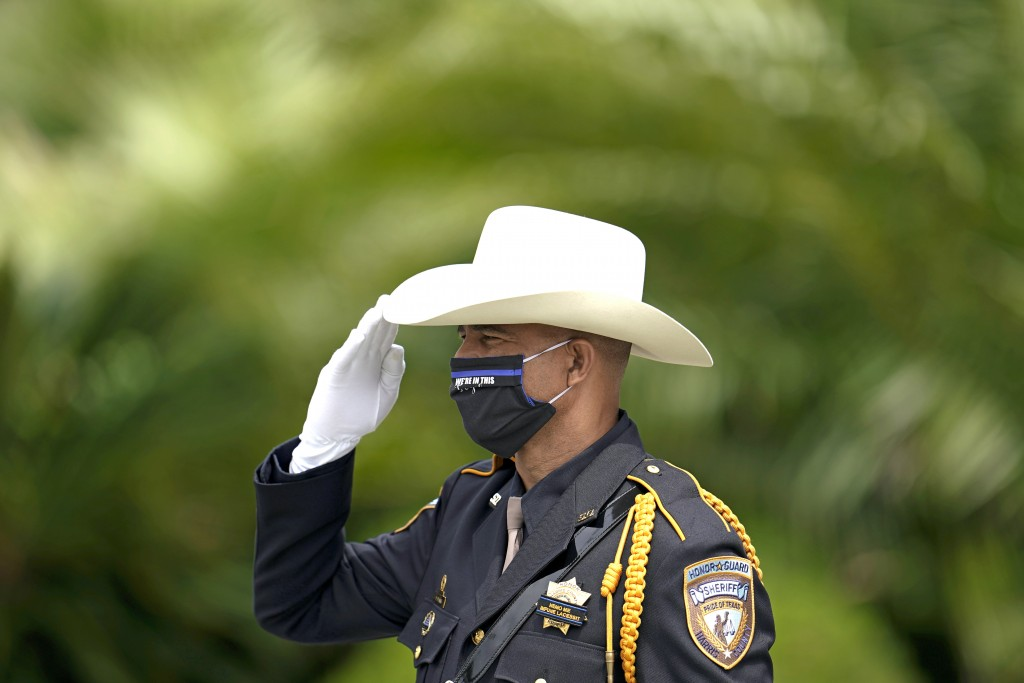 Harris County Sheriff's Deputy Darryl Peaks rehearses with honor guard members outside at Humble First Assembly of God during the funeral service for ...