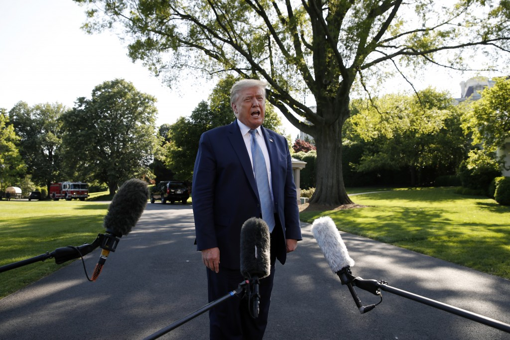 President Donald Trump speaks with reporters as he departs the White House on Marine One, Friday, May 15, 2020, in Washington. Trump is en route to Ca...