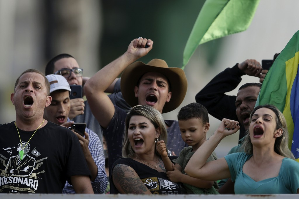 A crowd gathers in front of the Planalto presidential palace to show their support for Brazil's President Jair Bolsonaro, in Brasilia, Brazil, Friday,...