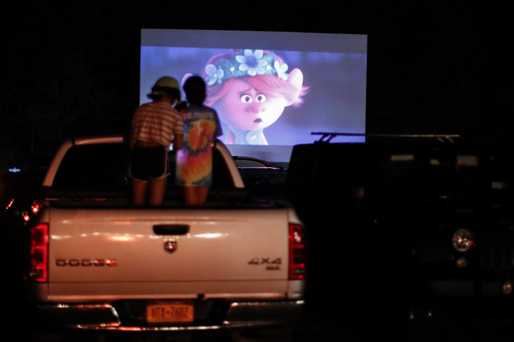 """Guests watch a showing of """"Trolls World Tour"""" at the Four Brothers Drive In Theatre, Friday, May 15, 2020, in Amenia, N.Y., during the coronavirus pan..."""