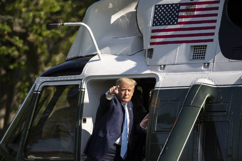 President Donald Trump points as he departs the White House on Marine One, Friday, May 15, 2020, in Washington. Trump is en route to Camp David, Md. (...