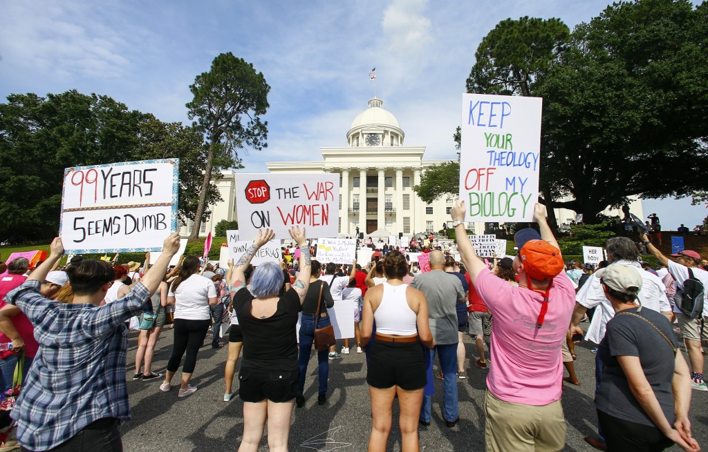 FILE - In this Sunday, May 19, 2019, file photo, protesters for women's rights hold a rally on the Alabama Capitol steps to protest a law passed the p...