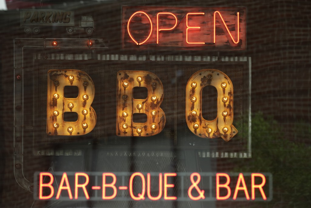 A restaurant displays an open sign as it opened for dine-in customers Friday, May 15, 2020, in downtown Kansas City, Mo. Restaurants were allowed to s...