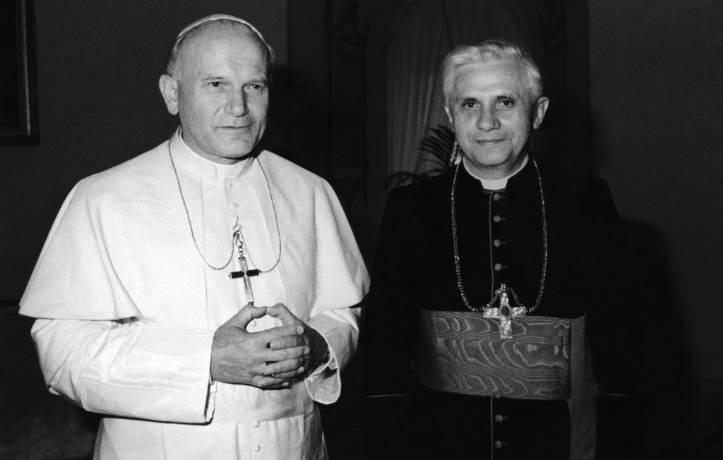 FILE - In this 1979 file photo, Pope John Paul II, left, poses with Cardinal Joseph Ratzinger, who was elected Pope on April 19, 2005 and chose Benedi...