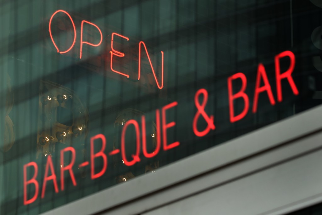 A restaurant displays an 'open' sign as it allowed dine-in customers Friday, May 15, 2020, in downtown Kansas City, Mo. Restaurants were allowed to se...
