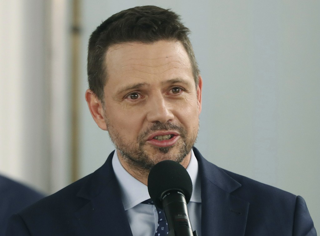 New candidate in Poland's presidential election for the opposition Civic Coalition, Warsaw Mayor Rafal Trzaskowski talks to reporters, taking over fro...