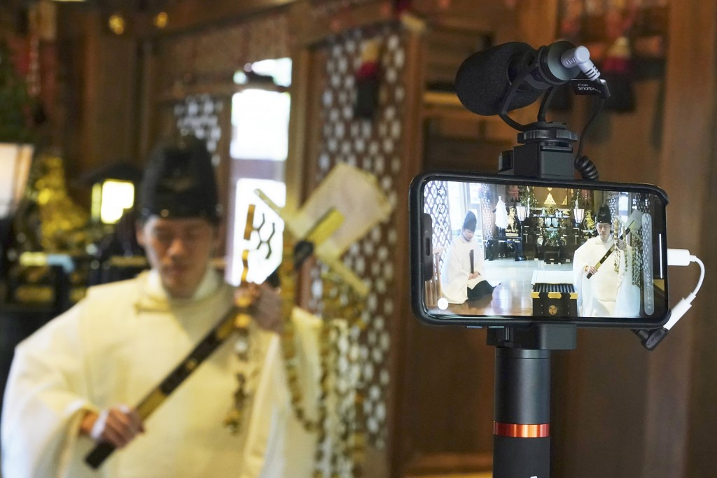 """In this May 8, 2020, photo, Ryoki Ono, head priest, performs a livestream prayer during a 10-day trial of """"online shrine"""" visit program at Onoterusaki..."""