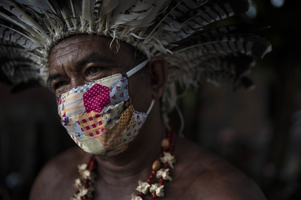 In this May 10, 2020 photo, Pedro dos Santos, the leader of a community named Park of Indigenous Nations, poses for a photo, in Manaus, Brazil. Manaus...