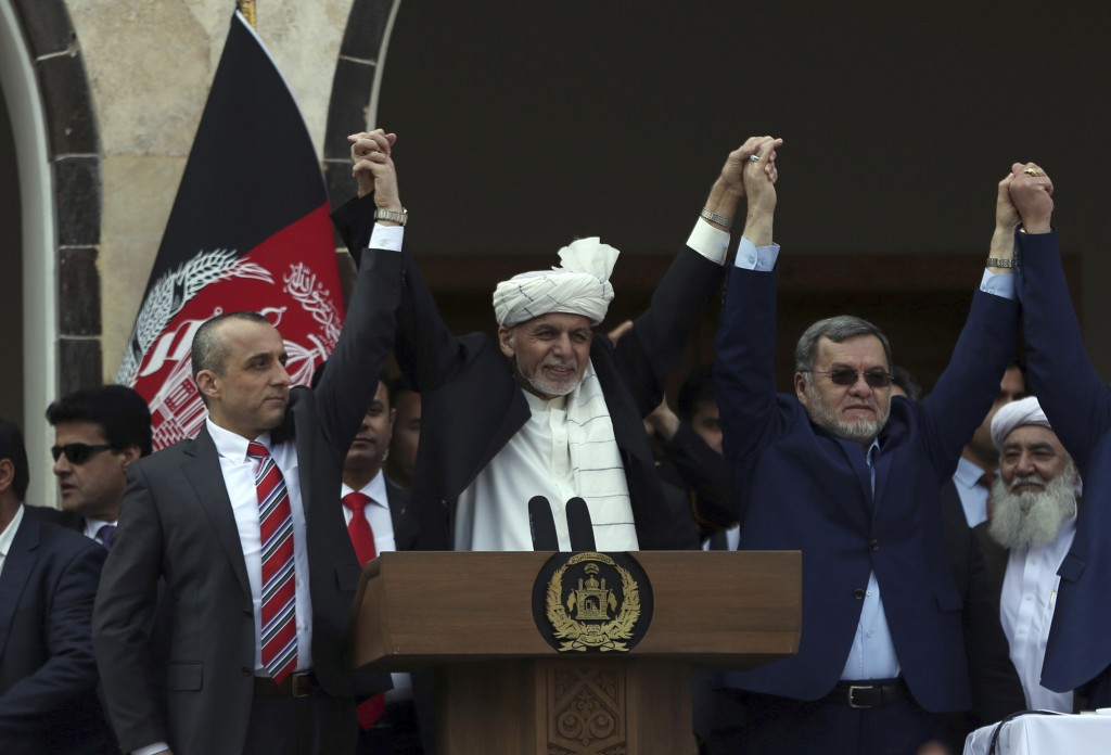 FILE - In this March 9, 2020, photo, Afghan President Ashraf Ghani, center, second Vice President Sarwar Danish, right, and first Vice President Amrul...