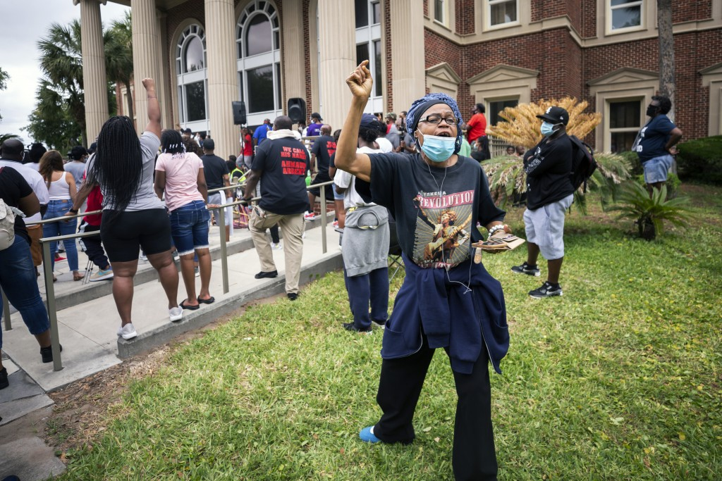 A woman shouts during a rally at the Glynn County Courthouse to protest the shooting of Ahmaud Arbery, Saturday, May 16, 2020, in Brunswick, Ga. (AP P...