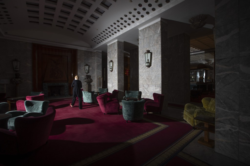 In this Tuesday, May 12, 2020 photo, Stefania Bettoja, one of the owners of Hotel Meditarraneo Bettoja, walks in the empty hall of the hotel, which is...