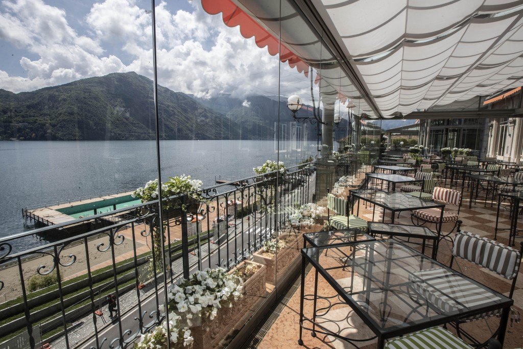 This picture taken on Thursday, May 14, 2020, shows the outdoor restaurant overlooking the swimming pool and lake of the historical Grand Hotel Tremez...